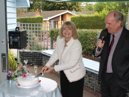 Harriett Baldwin MP cuts the celebration cake marking the opening of the new Alfrick Village Store with chairman Alan Soper