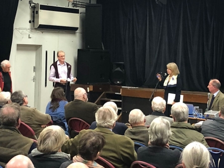 Harriett Baldwin MP answers a question from local businessman Guy Bryan Brown (left) with event chairman Michael Hodges (seated,