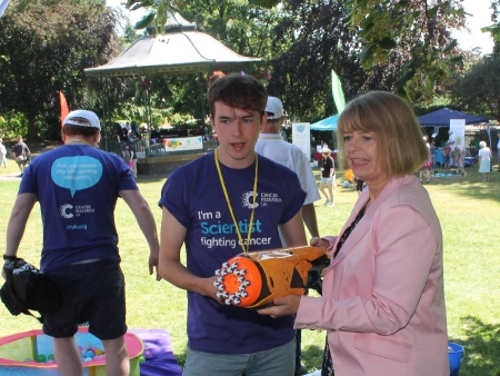 Cancer Research physicist Matt Wray gives Harriett Baldwin MP a demonstration on how technology is improving cancer treatments.