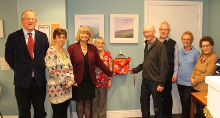 Councillor Paul Tuthill (far left) and Harriett Baldwin MP lead the unveiling of the new defibrillator at Clarence Park