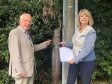 Councillor Tony Penn and Harriett Baldwin MP at the site of the missing post box on Berrington Road in Tenbury.