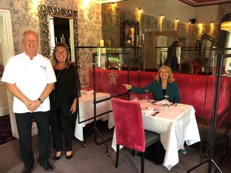 Chris and Barbara Morgan show Harriett Baldwin MP the new Perspex screens installed at the Cotford Hotel's restaurant L'Amuse Bo