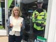 MP Harriett Baldwin taking her local police crime summit invitations to Barnards Green traders.