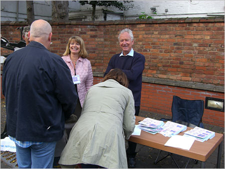 Harriett Baldwin and Sir Michael Spicer, MP with residents of Worcestershire signing the petition