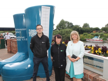 Upton 10 years' flood free: Environment Agency's James Spry and Nicola Manley with Harriett Baldwin MP