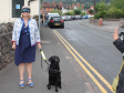 Harriett Baldwin MP braves the streets in Barnards Green with a blindfold assisted by guide dog Ross