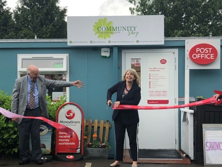 Harriett Baldwin MP cuts the ribbon at the Lower Broadheath Community Shop with chairman Mark Glossop.
