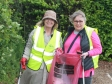 Harriett Baldwin MP (left) goes litter picking in Upton-upon-Severn with Debbie Collings.