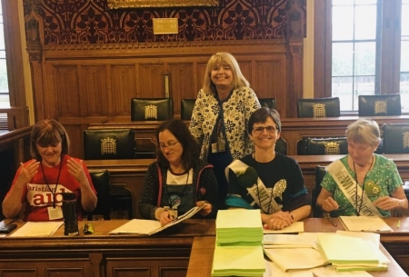 Alison Clarke, Anna Silver, Julia Goodfellow-Smith and Jenny Doyle with (standing) Harriett Baldwin MP