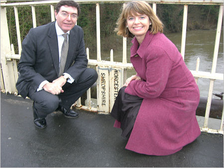Harriett Baldwin and Ludlow MP Philip Dunne compare peeling paint on the bridge over the River Teme